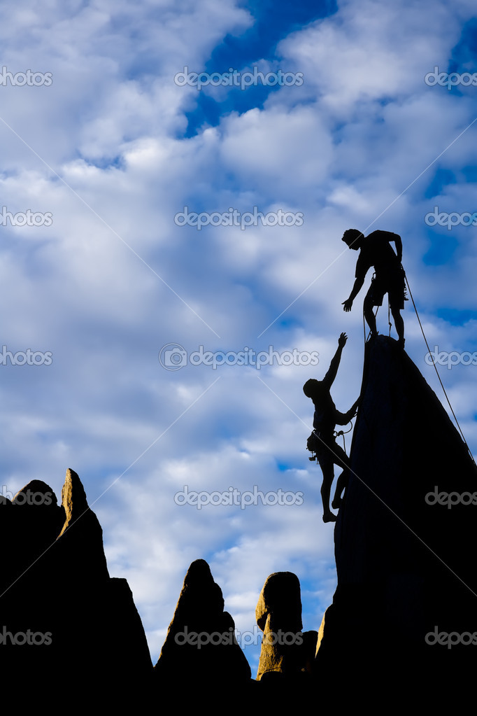 Team Of Climbers On The Summit Stock Photo