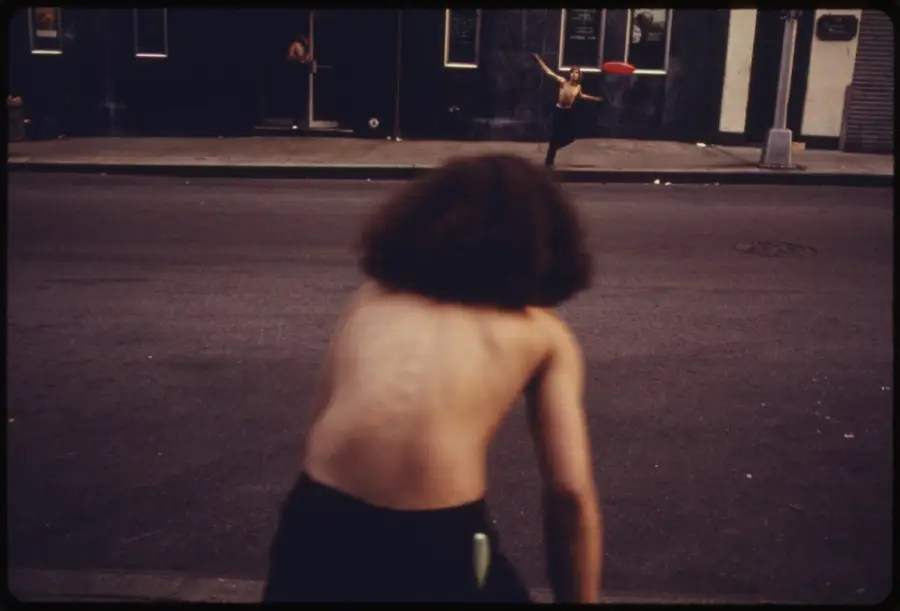 Playing Frisbee in the street
