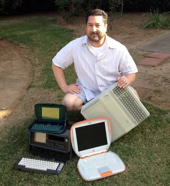 David Greelish with oldies but goodies: an Apple eMate, Apple IIe, Commodore SX-64 and iBook.