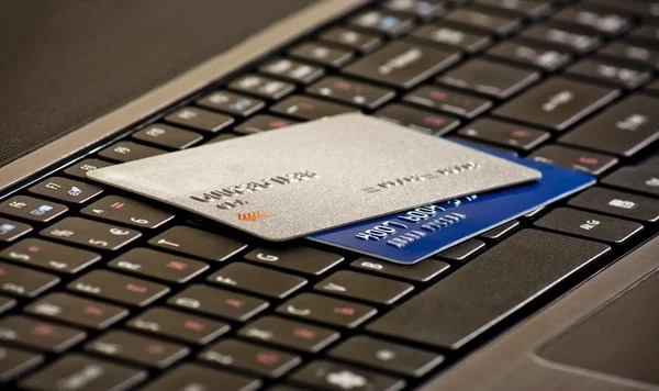 Credits cards on a computer keyboard stock image