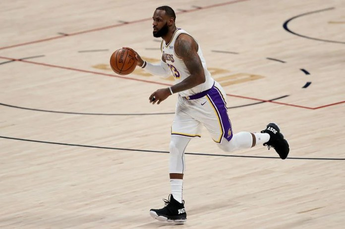 LeBron James of the LA Lakers brought the ball up against the Denver Nuggets