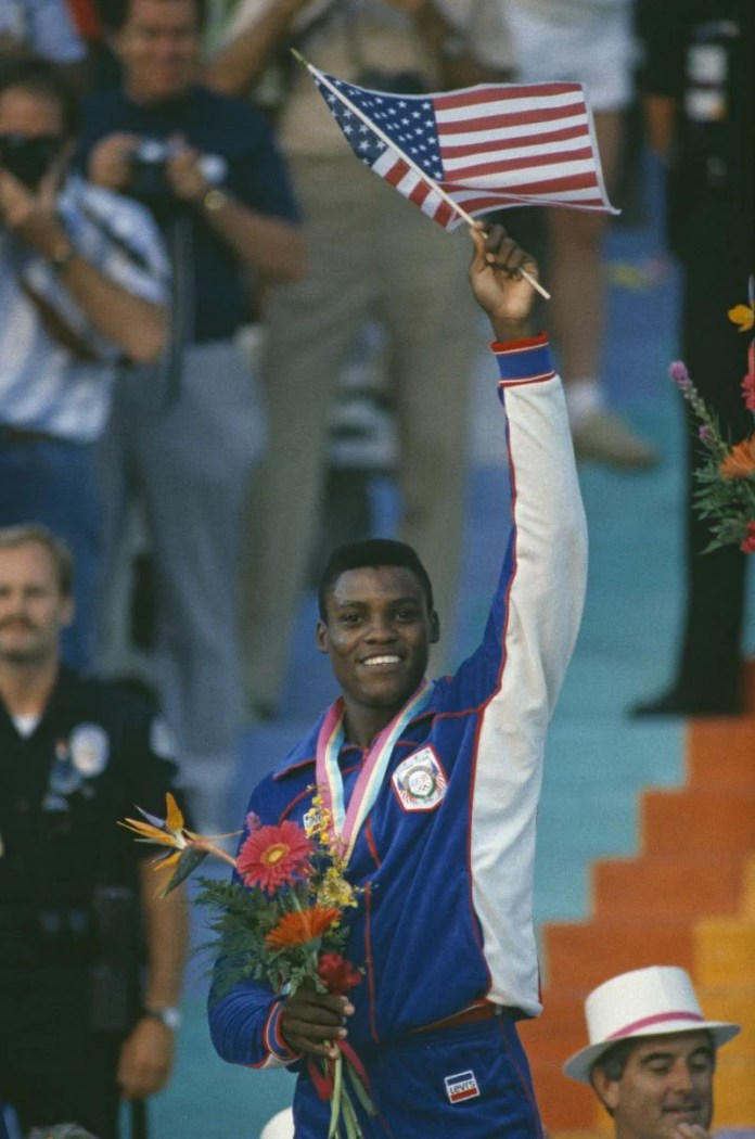 Carl Lewis smiles during the 1984 Olympics