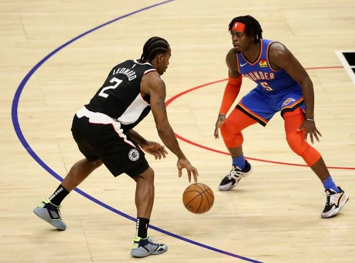 Qui Leonard of the Los Angeles Clippers handles the ball against Lugentz Dort of the Oklahoma City Thunder