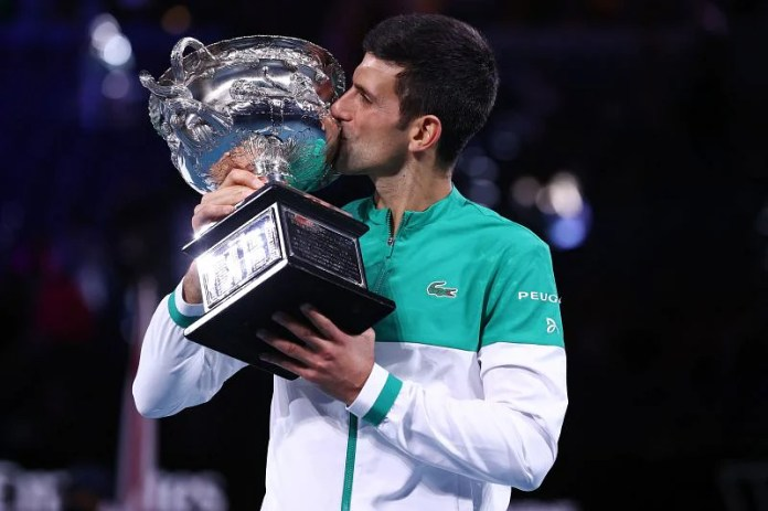 Novak Djokovic with his 9th Australian Open title