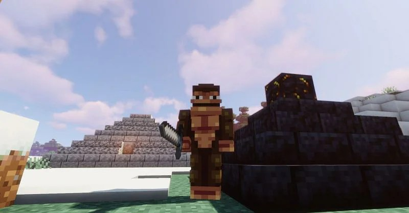 Shown: A Monke standing next to his monolithic creations (Image via Minecraft)