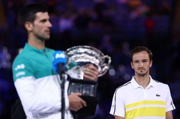 Novak Djokovic and Daniil Medvedev (R)