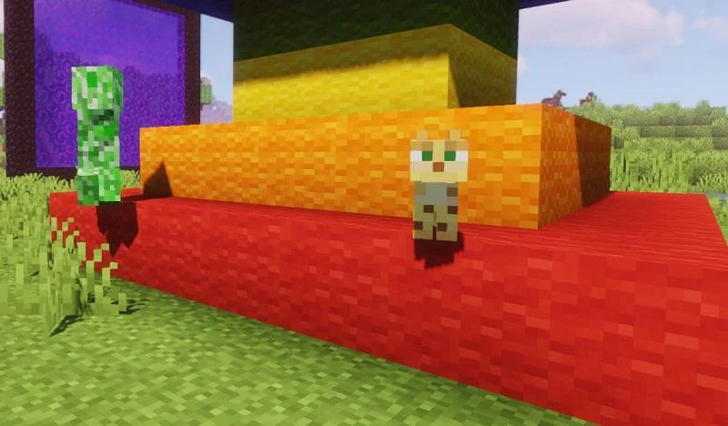 A Creeper booking it away from an unaware Ocelot (Image via Minecraft)