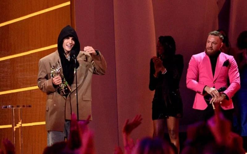 Justin Bieber (left);  Conor McGregor (right) at the MTV VMAs