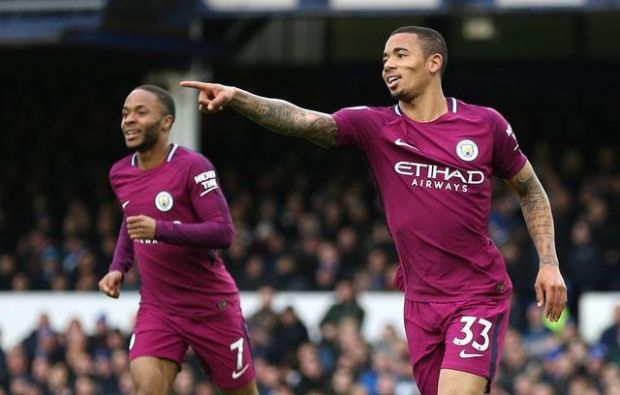 Raheem Sterling and Gabriel Jesus celebrate the latter's goal against Everton