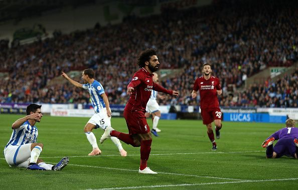 Salah wheels away to celebrate his finish