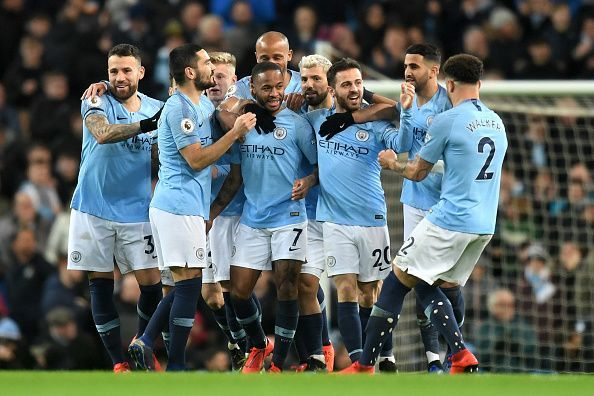 Manchester City players celebrate one of Sterling's strikes in an action-packed second-half