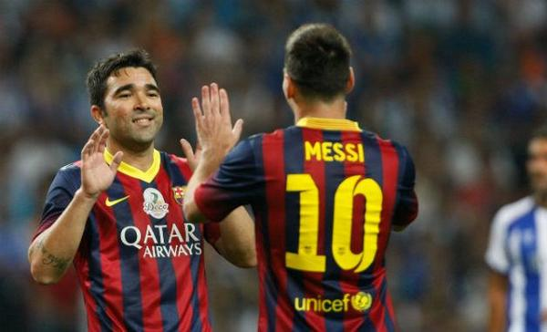Deco scores a brace during star studded testimonial between Porto     Deco celebrates a goal with Leo Messi
