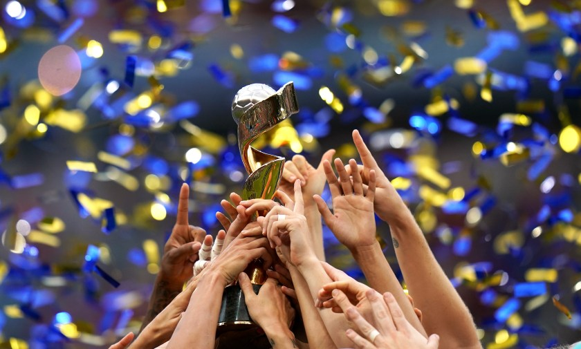 The Women's World Cup trophy held aloft by winners the United States