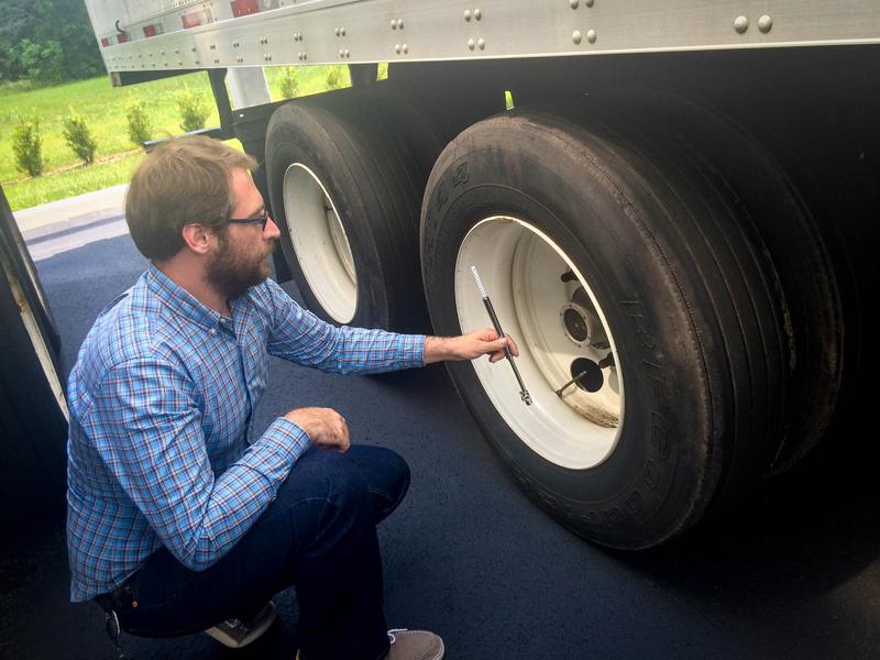 Status Trucks Tire Safety - Inspecting tire pressure