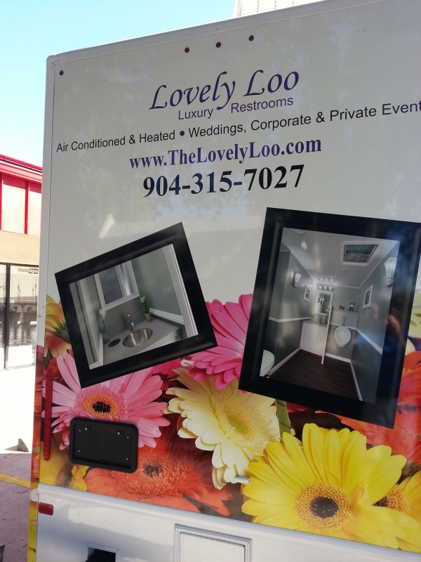 vehicle signage wrap by st augustine quick signs for lovely loo