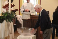 Renewing our baptismal vows.
