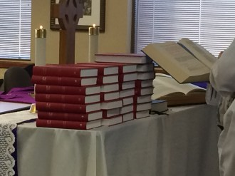 The blessing of the hymnals at the altar.