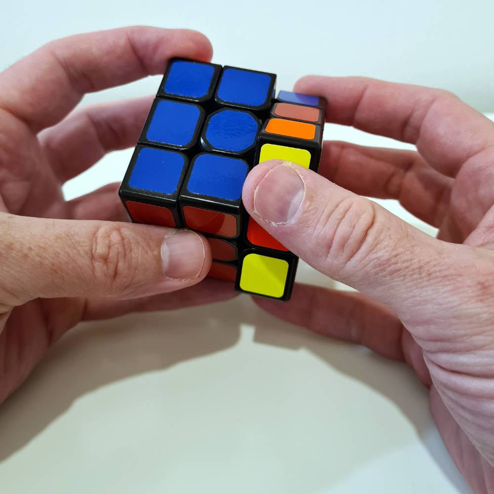 Mr Moore trying to solve a cube