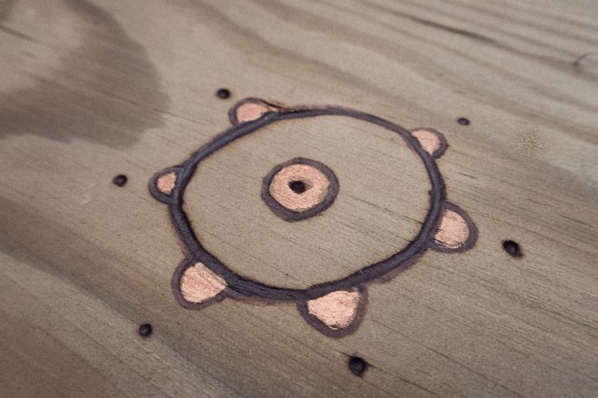 Burnt folk pattern in wood