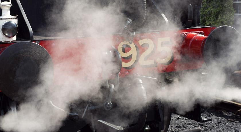 Steam rising around a train