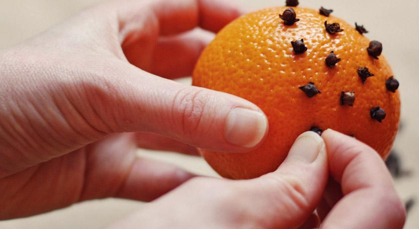 Studding an orange with cloves