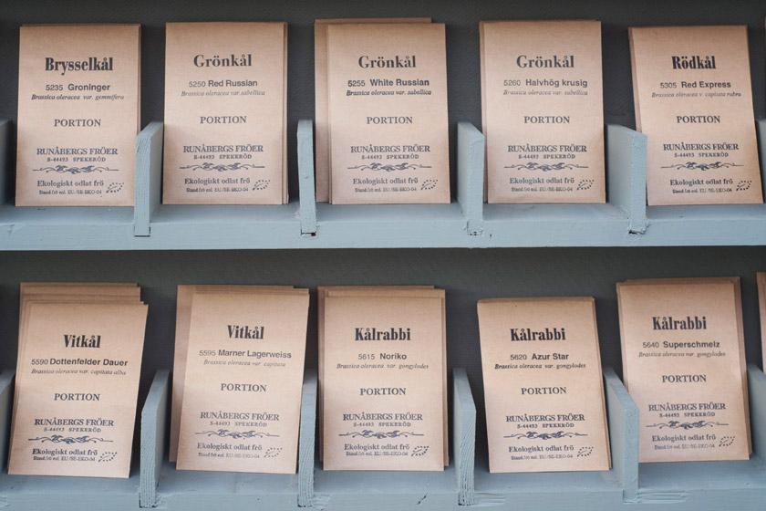 Seed packets on wood shelf