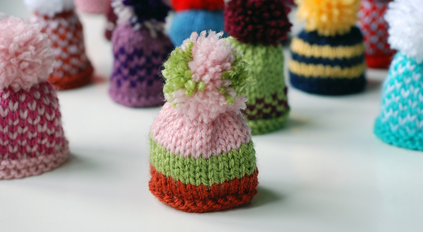 Pink, green and orange stripy hat