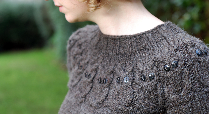 Neck view of owl jumper