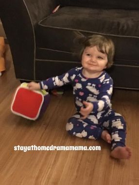 11 month old Maddy rolling the cube