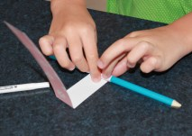 Roll the paper strips around a pencil