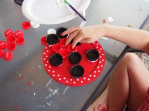 Glueing bottle caps