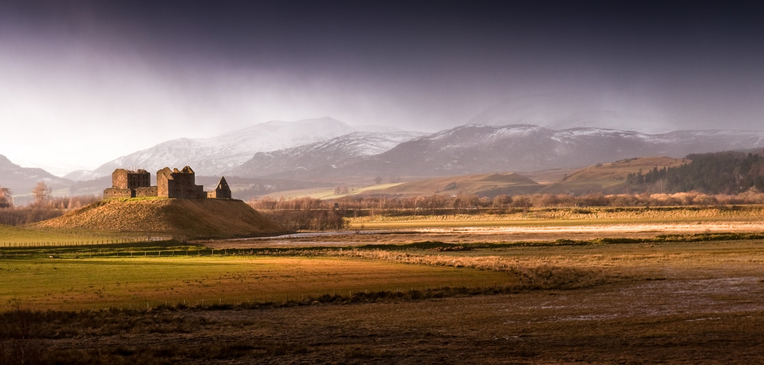 Ruthven Barracks ruin on a small hill in the shadow of the Cairngorm Mountains in the Highlands of Scotland