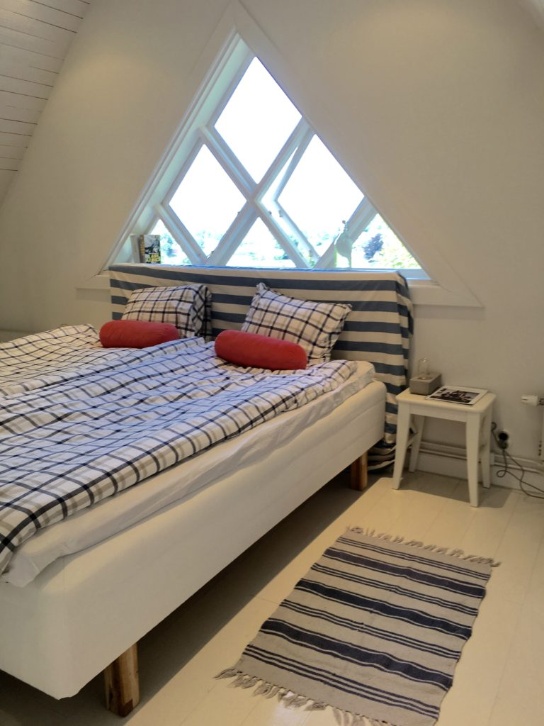 Large bedroom with view of the river and sea