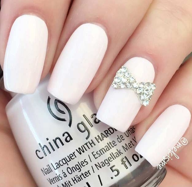 Long White Nails with Bow Accent Nail