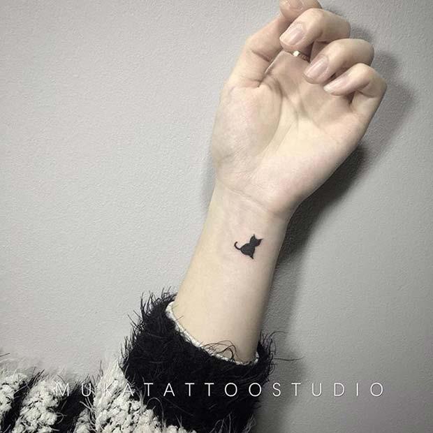 Small Cat Design for Women's Wrist Tattoo Ideas