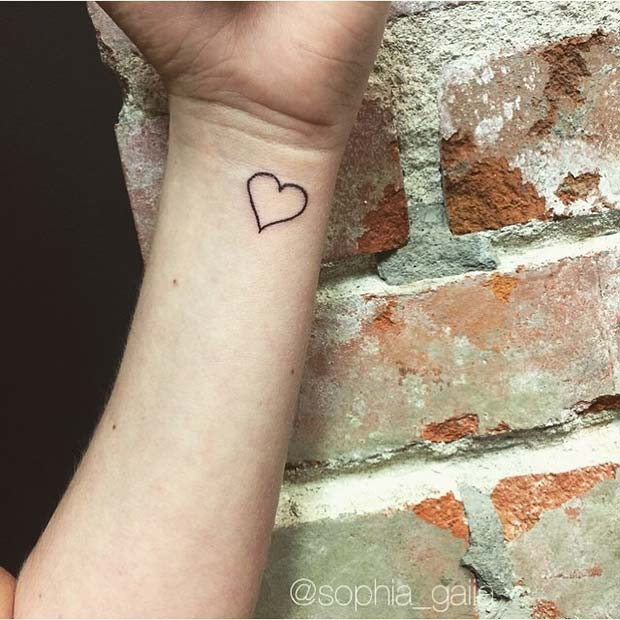 Heart Outline Women's Wrist Tattoo Idea