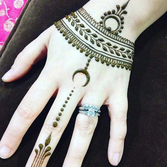 Pretty Henna Design with a Small Moon