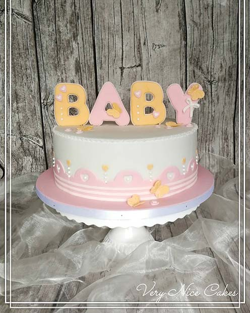 Simple Cake With Bright Baby Topper