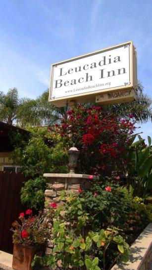 Leucadia Beach Inn Entrance with flowers.