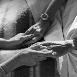 old woman holding caregivers hands