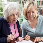 senior and younger woman working together