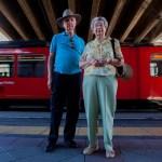 elderly couple on train platform