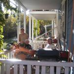 a community relaxing on a large porch