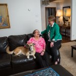 senior mother & daughter with a dog on a couch