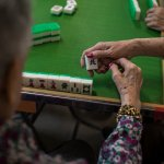 Playing mah-jongg at a nursing home in New Jersey.