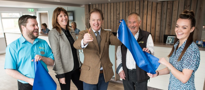 Hugo Swire MP (centre) officially opens Ladram Bay's new reception area in the company of (left to right) reception team member Jamie Newman, park directors Zoe House and Robin Carter, and reception team member Jasmin Horne.