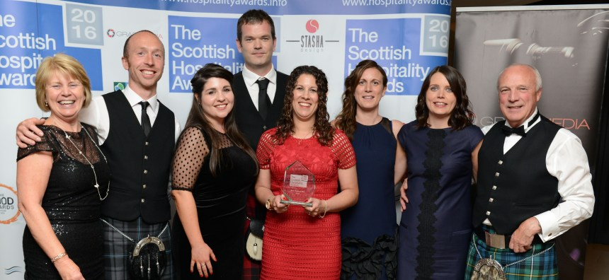 Members of the Wood family and their park managers celebrate the award. From the left are Margaret Wood, Calum MacGregor, Jenna Morrison, Bruce Thomson, Carlie Woods, Kirsty Wood Thomson, Sarah Wood MacGregor, and Colin Wood