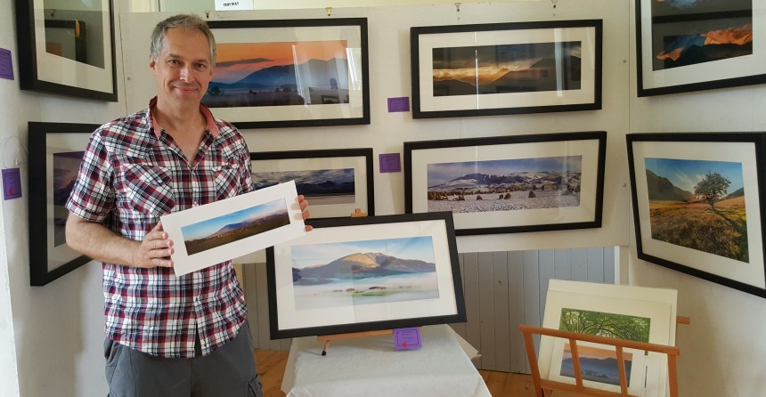 David Jackson with some of the framed Lake District studies which helped give a boost to community funds