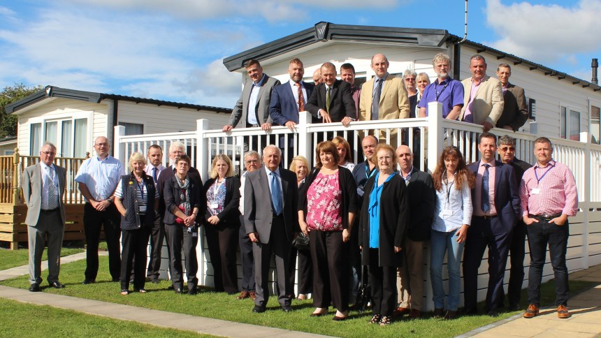 Simon Hart (top, centre) with West Wales holiday park owners at their post-summer conference in Kilgetty, near Tenby