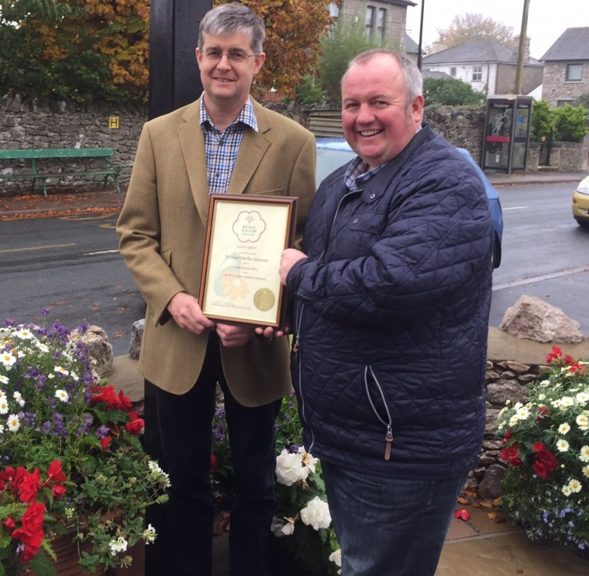 Michael Holgate (left) is congratulated at The Royal by NW in Bloom judge and BBC presenter Stephen Lowe